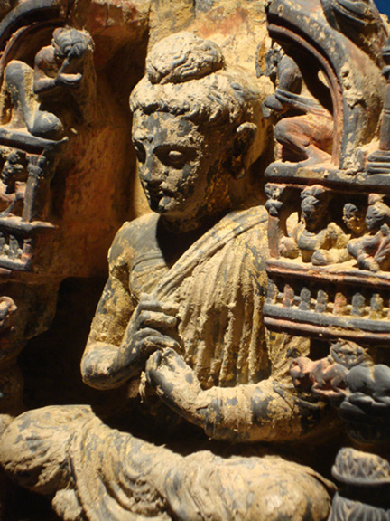 Detail of parcel gilt and polychromed gray schist figure of the teaching buddha
