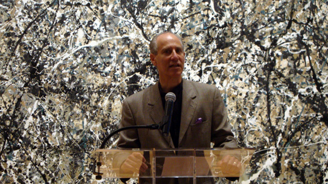 "Museum director Glenn Lowry with ""Number 1A"" by Pollock"