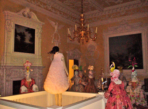 Orchid-themed hats by Phillip Treachy atop mannequins in the Kirklinton Park Dining Room