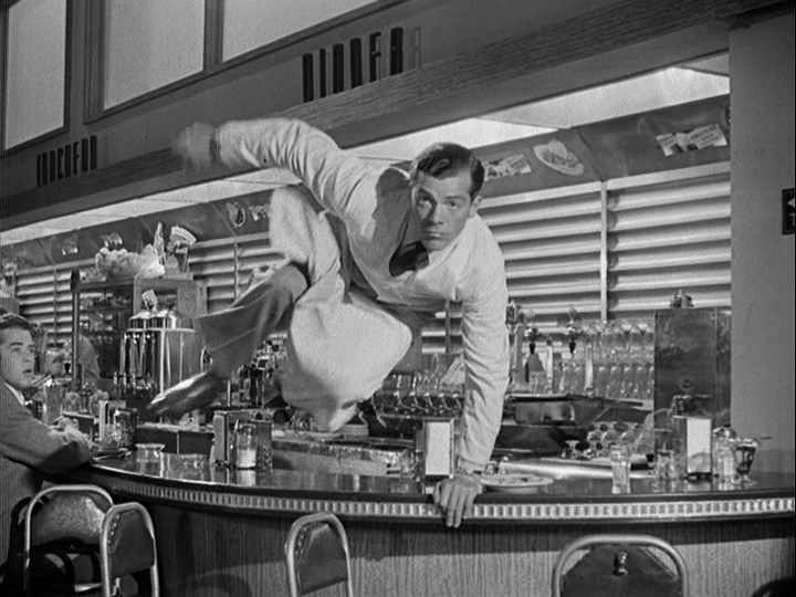 Dana Andrews leaps to Harold's defense
