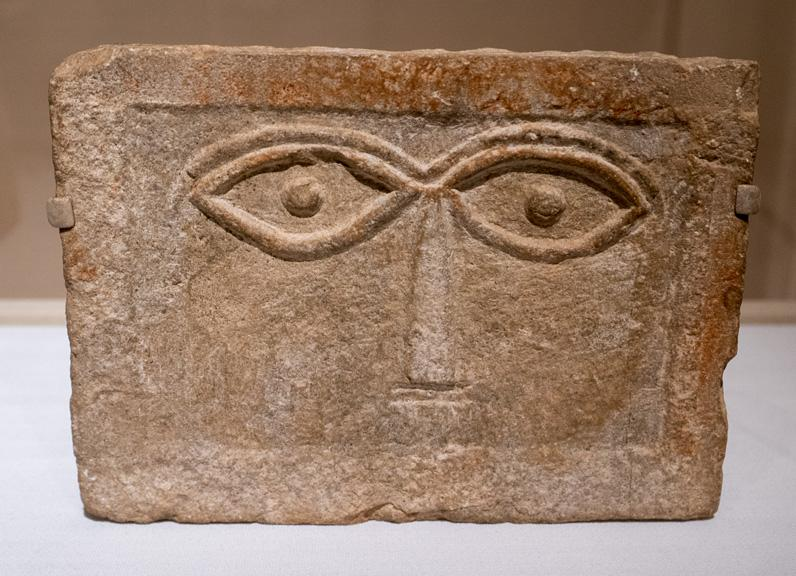 Stele with schematic face