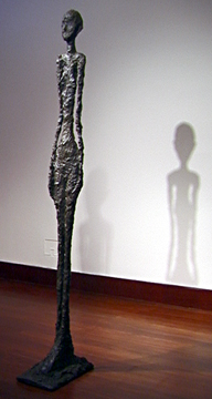 Standing woman by Giacometti