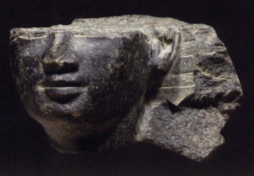 Fragmentary Egyptian basalt head of a king