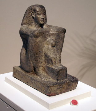 Egyptian serpentine block statue of man