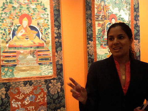 Christie's specialist Sandhya Jain-Pael with central Thangka of the Great Fifth Dalai Lama