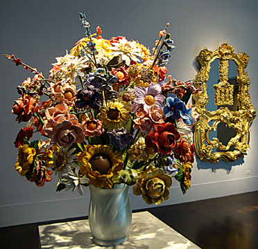 """Large vase of flowers"" and ""wishing well"" by Koons"