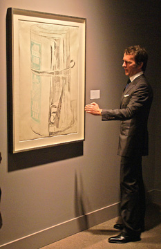 "Tobias Meyer in front of ""Untitled (Roll of Dollar Bills"" by Warhol"