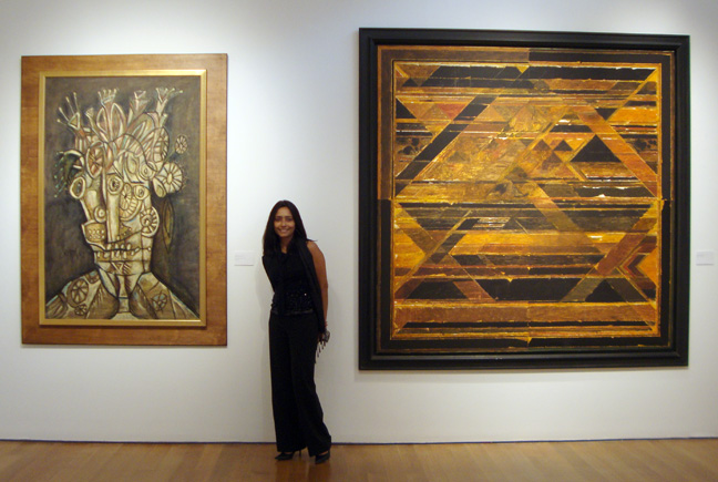 Deepanjana Klein of Christie's with two paintings by Souza