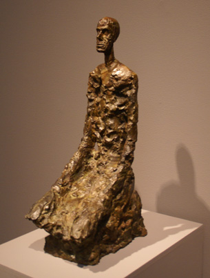 Kneeling man by Giacometti