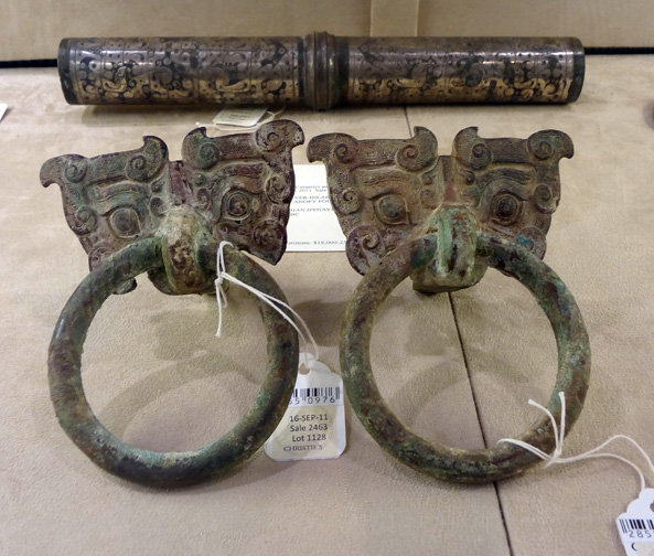 Pair of bronze mask and ring handles, foreground