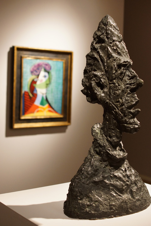 Giacometti head and Picasso painting