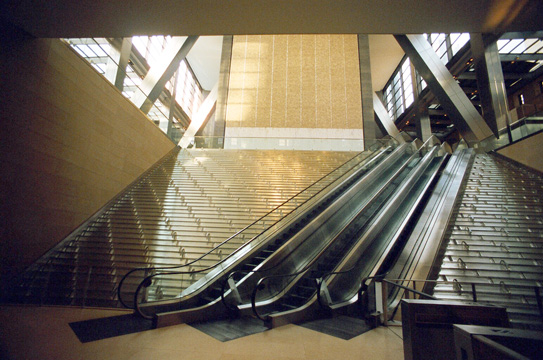 Angled escalators cross stepped waterfall created by Jamie Carpenter