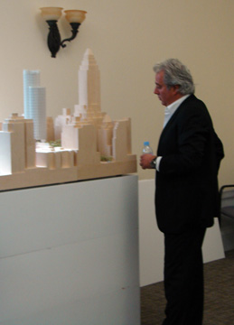 Aby Rosen looking at model of new tower
