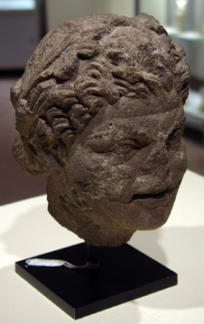 Roman basalt head of a satyr