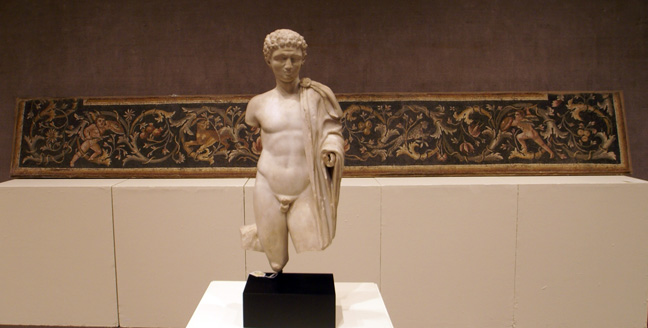 Roman marble statue of Mercury, foreground, Roman marble mosaic panel, background
