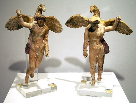 Zeus as eagle hold Ganymede, a pair of terracottas