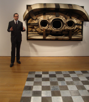 Untitled sculpture by Bontecou, background, and part of floor sculpture by Andre, foreground