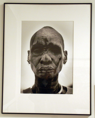 """Dinka man at the cattle camp"" by Salgado"
