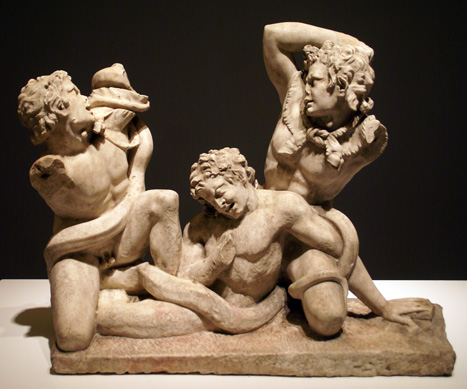 Roman marble group of three satyrs fighting a serpent