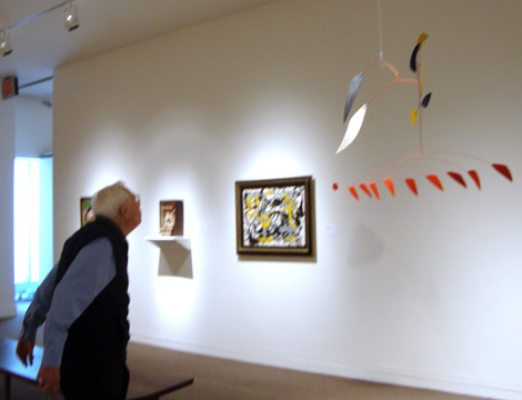 "Visitor at Sotheby's ""blowing"" at Calder mobile"