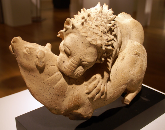 Terracotta lion and cow