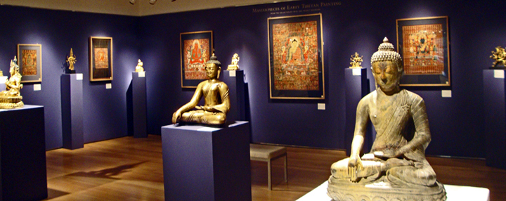 Gilt bronze of Buddha, left, rare black stone figure of Buddha, right