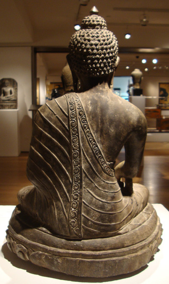 Rear of black stone figure of Buddha
